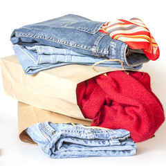 Shopping: a woolen jumper and jeans of various shades in paper p