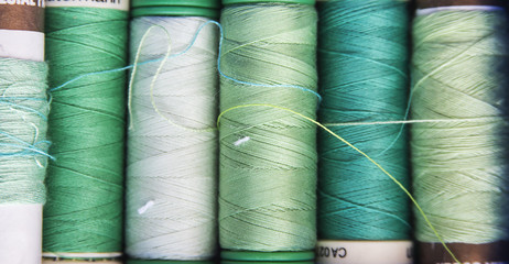 Green spools of sewing