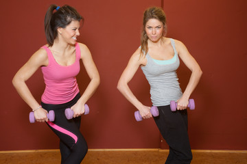 Fitness Training - 2 girls with barbell