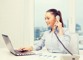 businesswoman with phone, laptop and files