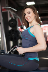 Portrait of smiling girl on training apparatus