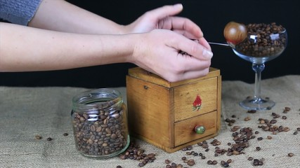 woman make coffe powder with a coffee grinder
