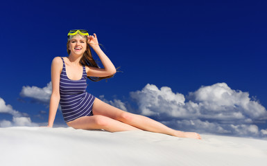 Girl with diving mask on the beach