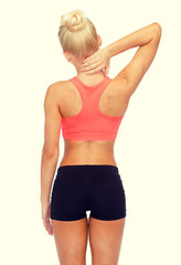 sporty woman touching her neck