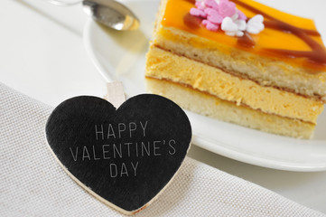 happy valentines day in a heart-shaped chalkboard and a piece of