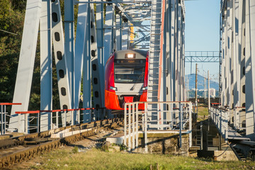 Train passes on bridge