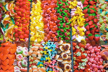 Market stall full of candys at the Boqueria in Barcelona