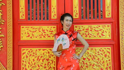 Woman in red dress, Cheongsam dress of Chinese traditional.