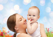 happy mother with baby over natural background