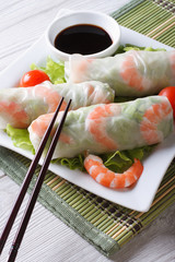 spring roll with shrimp and sauce on a plate. Vertical
