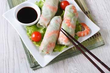 Korean spring rolls with shrimp and sauce on a plate horizontal
