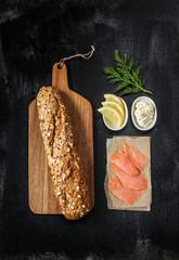 Smoked salmon sandwich recipe - ingredients on black