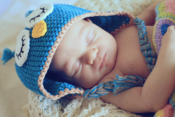 newborn in owl hat
