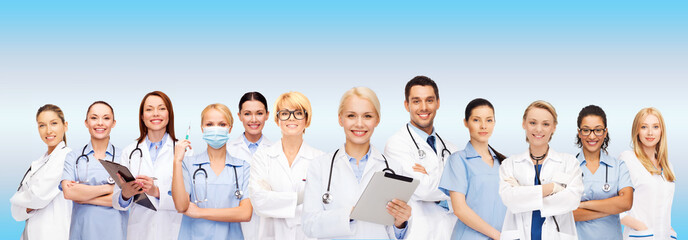 smiling female doctors and nurses with tablet pc