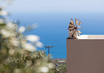 Windmill in miniature on the sill of a terrace with sea views
