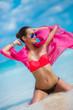 Sexy sandy woman on tropical beach.