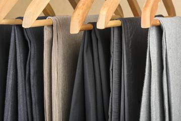 Pants on hangers.