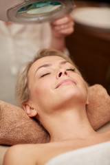 close up of young woman lying in spa
