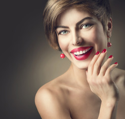 Happy smiling lady with shot brown hair and bright make-up