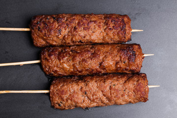 lula kebab on wooden skewers dark baking