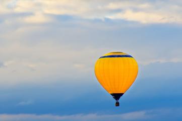 Air balloon on a blue sky background
