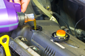 Adding oil in engine of a car