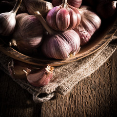 garlic bulb on rustic wooden background