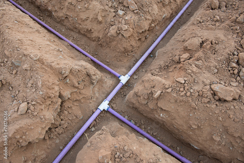 Foto op Aluminium Tuin Irrigation pipe in dirt trenches for sprinkler system