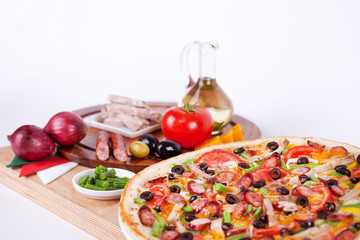 Italian pizza with sausage, beef, green beans, cheese
