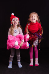 Two girls grimace and show language in Christmas clothes