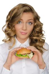 Surprised young woman with hamburger