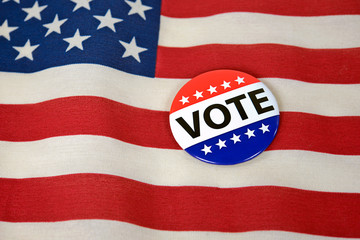 patriotic voting pin on American flag