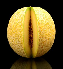 Melon galia notched isolated black in studio