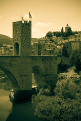 medieval town with bridge. Imitation of old image