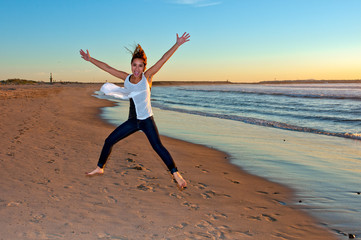 Leaping and bounding across the sandy beach