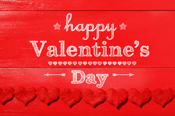 Happy Valentine's Day message on red wood