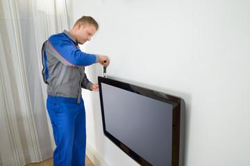 Technician Repairing Television