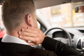 Man Suffering From Neck Pain While Driving
