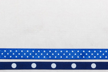 Dotted blue ribbon frame on white cloth
