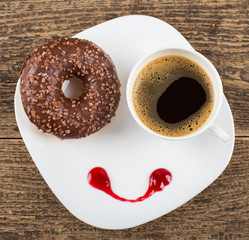 Coffee and donut at a dish with smile