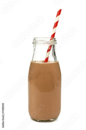 Leinwandbild Motiv Chocolate milk with straw in a bottle isolated