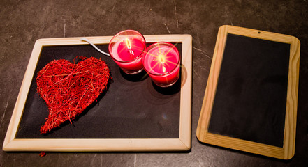 candle , roses , a blackboard