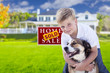 Boy and His Dog in Front of Sold Sign, House