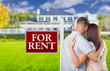 For Rent Real Estate Sign, Military Couple Looking at House