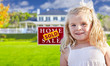 Girl in Yard with Sold Real Estate Sign and House
