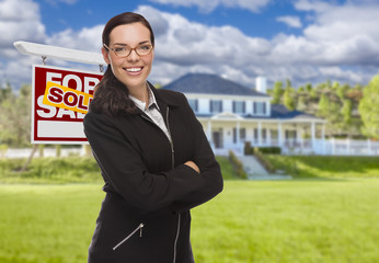 Mixed Race Woman in Front of House and Sold Sign