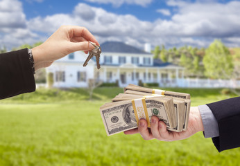 Handing Over Cash For House Keys in Front of Home