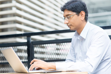 Indian businessman using laptop