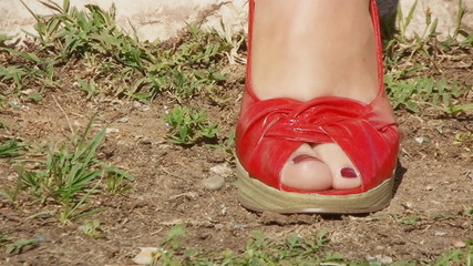Feet lifestyle rock red shoes travelling shot