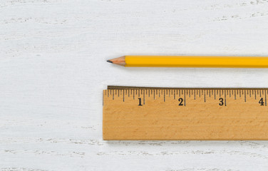 Wooden Ruler with Metal Edge and pencil